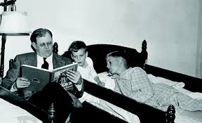Fred Koch reading to his sons