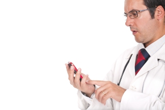 doctor-using-mobile-phone